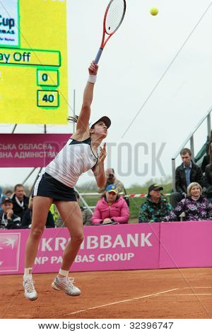 KHARKOV, UKRAINE - APRIL 22: Christina McHail serves a ball during Fed Cup tie between USA and Ukraine in Superior Golf and Spa Resort, Kharkov, Ukraine at April 22, 2012