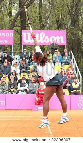 KHARKOV, UKRAINE - APRIL 22: Serena Williams serves a ball during Fed Cup tie between USA and Ukraine in Superior Golf and Spa Resort, Kharkov, Ukraine at April 22, 2012