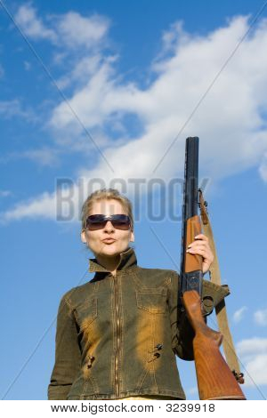 Blonde Girl In Sunglasses Holding Hunter Rifle.