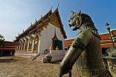 stock photo of palladium  - Bird head statue standing infront of the chapel in Wat Phra Keaw  - JPG