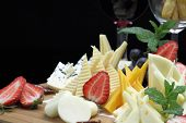 stock photo of fruit platter  - Various types of cheese on a cheese platter - JPG