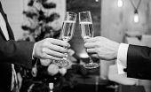 Drink Champagne At Party. Colleagues Celebrate New Year. Male Hands Formal Suit Hold Champagne Glass poster