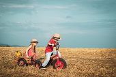 Little Bikers With Retro Tricycle. Eco Farm Workers. Two Little Children On Countryside Farm. Sweet  poster