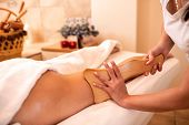 Masseuse Holding A Hand Held Wooden Massage Tool poster