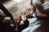 Close Up Of Married Couple Toasting Champagne Glasses At Wedding Party. Hands Bride And Groom Clinki poster