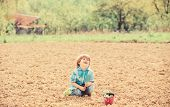 Small Kid Planting A Flower. Earth Day. New Life. Summer Farm. Happy Child Gardener. Botanic Worker. poster