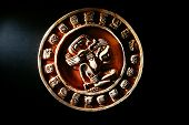 picture of hieroglyphic symbol  - A carved Mayan calendar in dramatic light - JPG
