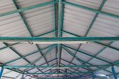 The Steel Structure Of The Roof. Structure Of Steel Roof Frame And Metal Sheet. Rusted Steel Structu poster