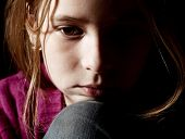 stock photo of child abuse  - Sad child on black background - JPG