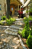 picture of stepping stones  - Landscaped front yard with natural stone steps and walkway