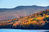 Lake with Autumn foliage and mountains in New England Stowe poster