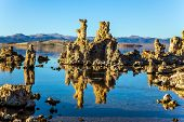 Picturesque Mono lake. California. The columns - remains of Tufa are fantastically reflected in th poster