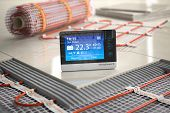 Underfloor heating. Heating climat control thermostat  with mat elecric heating system, ceramic tile poster