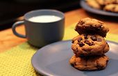 picture of chocolate-chip  - A stack of cookies threatens to topple over - JPG