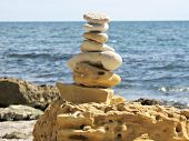 Beach Sand Stone Zen Cairn. A Stone Pyramid On Sea Shore. Simple Poise Pebbles Stack, Rock Zen Sculp poster