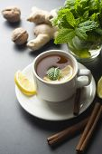 Cup Of Ginger Tea With Lemons And Mint Leaves On Dark Background. Ginger Tea, Drink Ingredients, Col poster