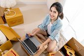 Young Smiling Asian Customer Woman Holding Credit Card And Payment With Laptop. Portrait Of Happy As poster