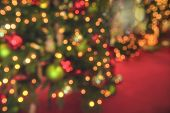 Christmas Tree Blur Background With Bokeh Lights. Xmas Lights On A Pine Tree On A Red Background. Ch poster