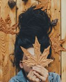 Autumn Woman. Fall Season Concept. A Portrait Of Lying On Wooden Floor Woman. Young, Beautiful And H poster