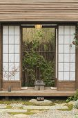 Details Of Idyllic Japanese House And Garden poster
