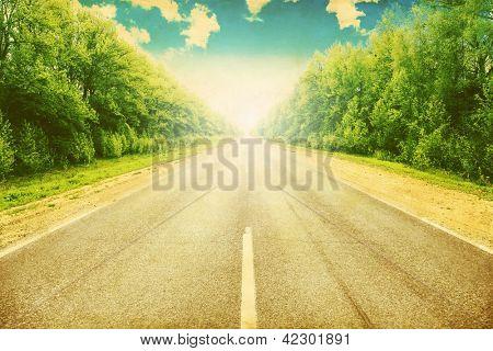 Grunge image of country asphalt road.