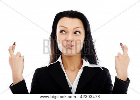 Businesswoman With Crossed Fingers Sign