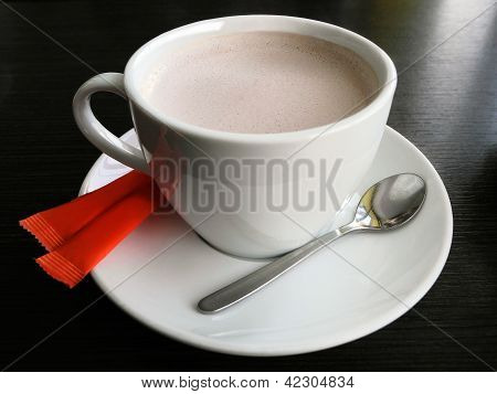 Cup of hot coffee with sugar