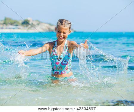 Girl swimming in sea