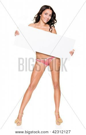 Young woman with blank sign in front of white background