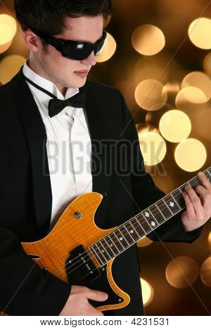 Attractive Teen Boy With Guitar