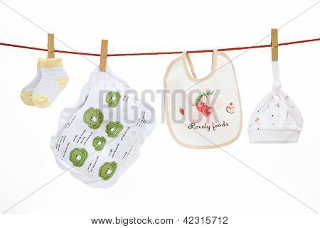 Baby Socks And Pillow And Bib And Cap Hanging With Clipping Path