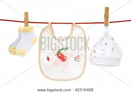 Baby Socks And Bib And Cap Hanging With Clipping Path