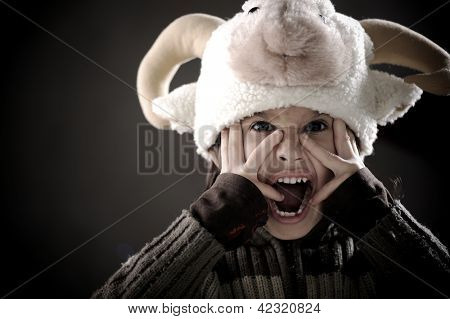 Portrait of authentic cute kid wearing funny sheep hat