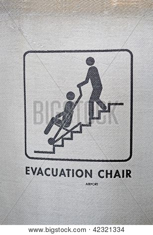 evacuation Chair Sign On Textured Surface, Help