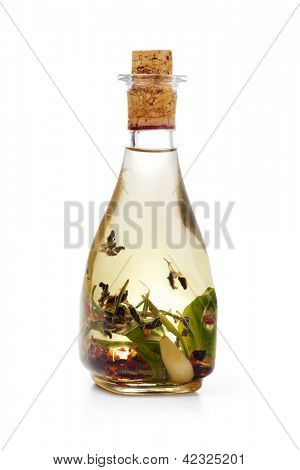 Bottles of aromatic olive oil with spicery on a white background
