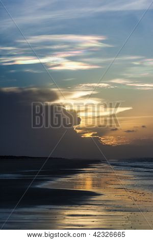 An image of a multi color cloud seen at 80 mile beach Australia