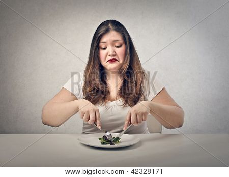 sad fat woman eating salad