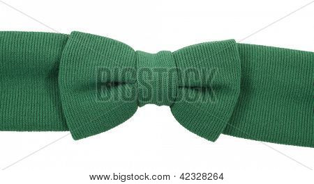 Green knitted bow tie on headband