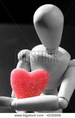Wooden Mannequin Holding A Red Jelly  Heart Shape