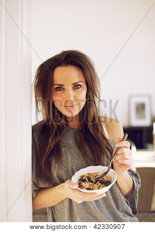 Woman With Messy Hair Eating Her Cereal