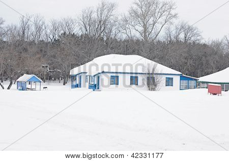 white cabin in winter woods