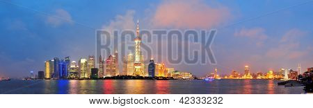 Shanghai city skyline at night over Huangpu river