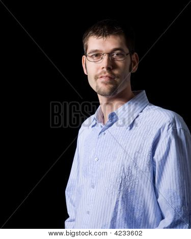 Man With Goatee And Glasses Smiles At Camera