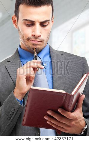 Businessman reading his agenda