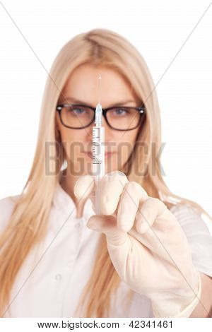 Medical doctor with syringe