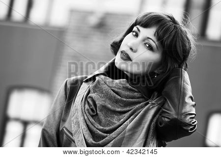 Beautiful young woman walking on the city street