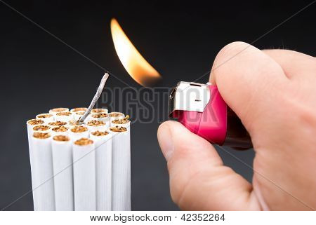 Igniting A Bundle Of Cigarettes With Tinder