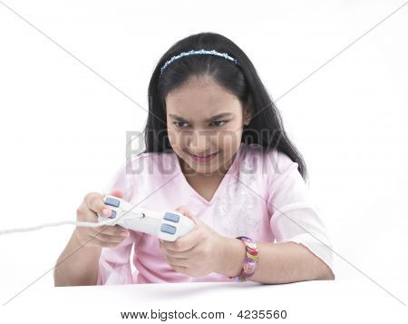 Asian Teenage Girl Of Indian Origin Playing With Her Play Station