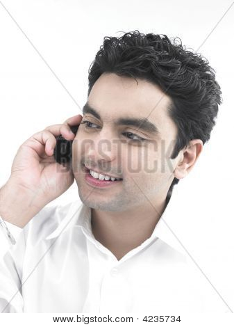 Asian Male Talking On His Cell Phone