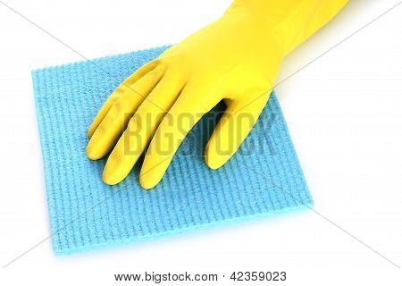 Hand with rubber glove and cleaning sponge